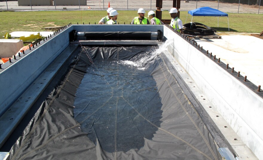 Engineers test the Flex-Gate, a big sheet of waterproof fabric designed to cover subway entrances and keep water out. Its creation was inspired in part by roll-up metal doors used to cover store entrances.
