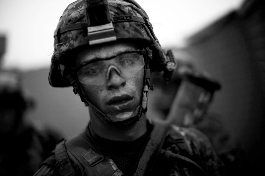 "Bravo Company's Pvt. Cody Lee Ensley walks through the safety of the gates at an American base after a daylong fierce attack by insurgents near Payendi. <em>From the story ""<a href=""http://www.npr.org/2010/10/22/130756452/signs-of-traction-in-u-s-fight-against-afghan-taliban"" target=""_blank"">Signs Of Traction In U.S. Fight Against Afghan Taliban</a>,"" 2010. </em>"