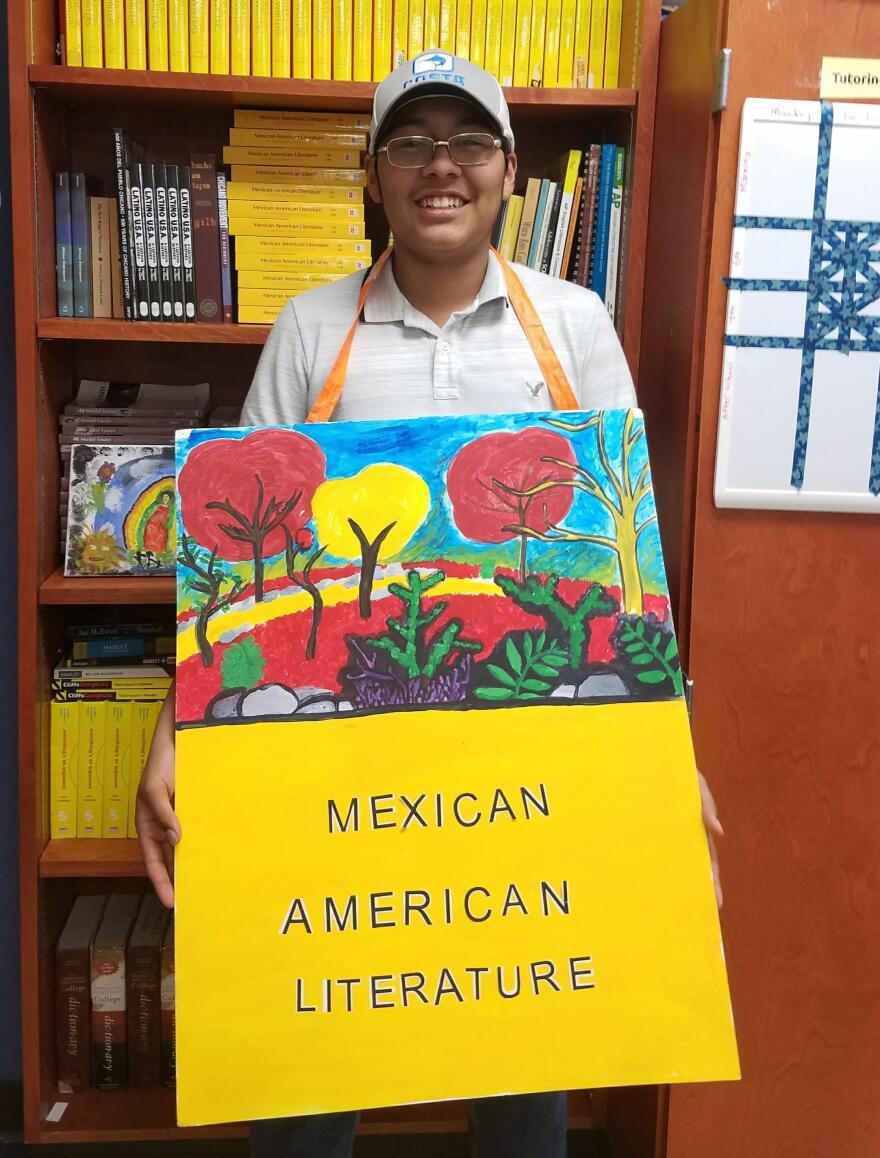 luis_silva_with_sign_designed_by_him.jpg