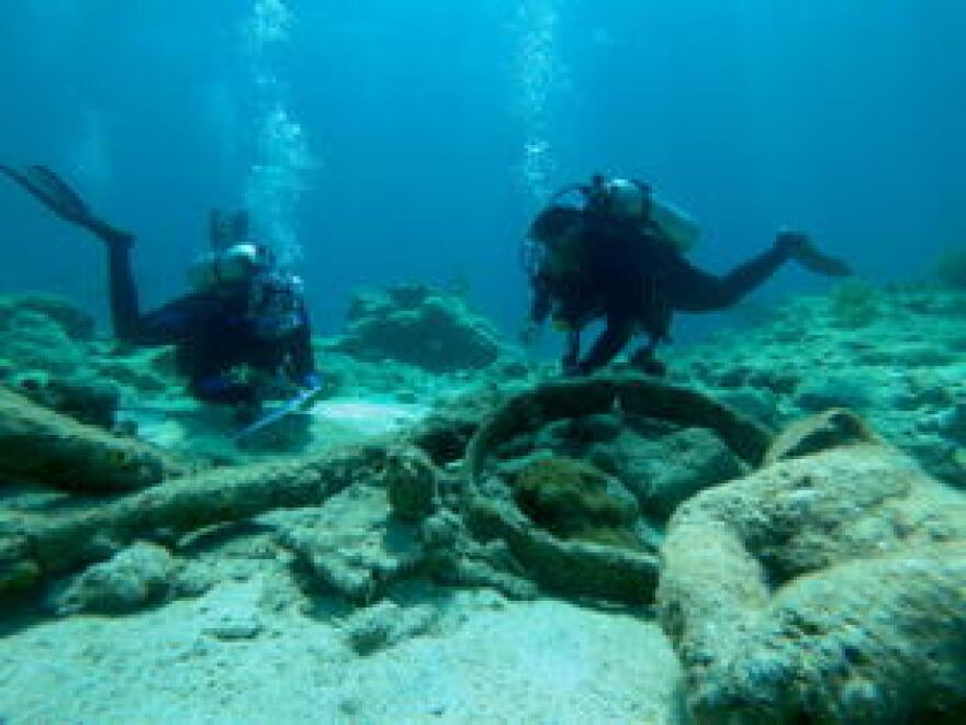 The divers don't remove anything from the site, but record locations to make a detailed site plan.