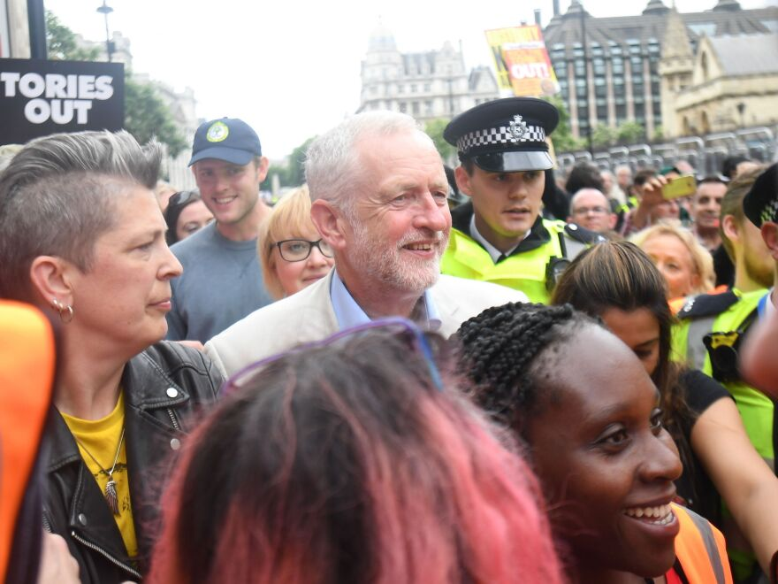 Labour leader Jeremy Corbyn is mobbed by young supporters after addressing an anti-austerity rally in Parliament Square, London, following a march through the city on July 1.