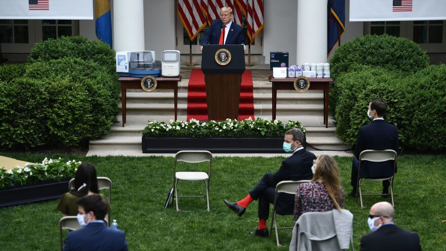 President Trump takes questions during a news conference on the coronavirus in the Rose Garden of the White House on Monday afternoon.