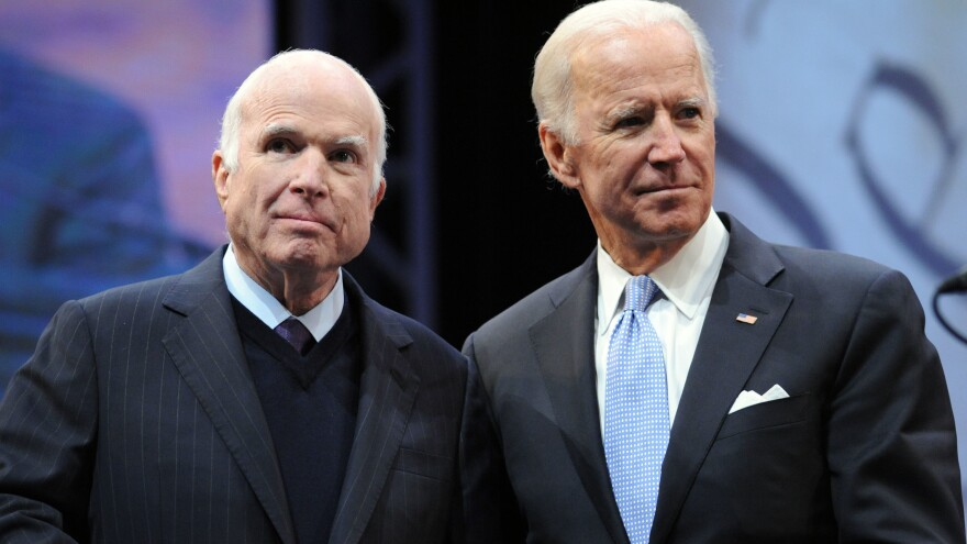 Sen. John McCain, R-Ariz., receives the the 2017 Liberty Medal from former Vice President Joe Biden in October 2017. McCain sought out friendships with Democrats, from Biden to Ted Kennedy to Hillary Clinton.