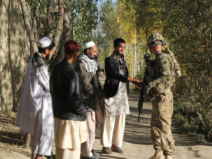 U.S. troops from the 1-91 Cavalry question Afghan civilians in Baraki Barak district in Logar Province, south of Kabul.