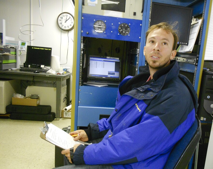 "Aidan Colton is a research scientist at the Mauna Loa Observatory. Here in the ""carbon cycle room,"" he measures the amount of carbon dioxide, methane and carbon monoxide in air from intake ports at the top of a 120-foot tower outside the lab."