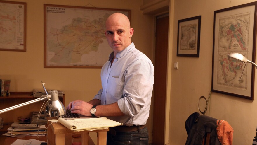 <em>New York Times </em>correspondent Matthew Rosenberg stands at his desk at the paper's office in Kabul on Wednesday. Afghanistan gave Rosenberg 24 hours to leave the country.