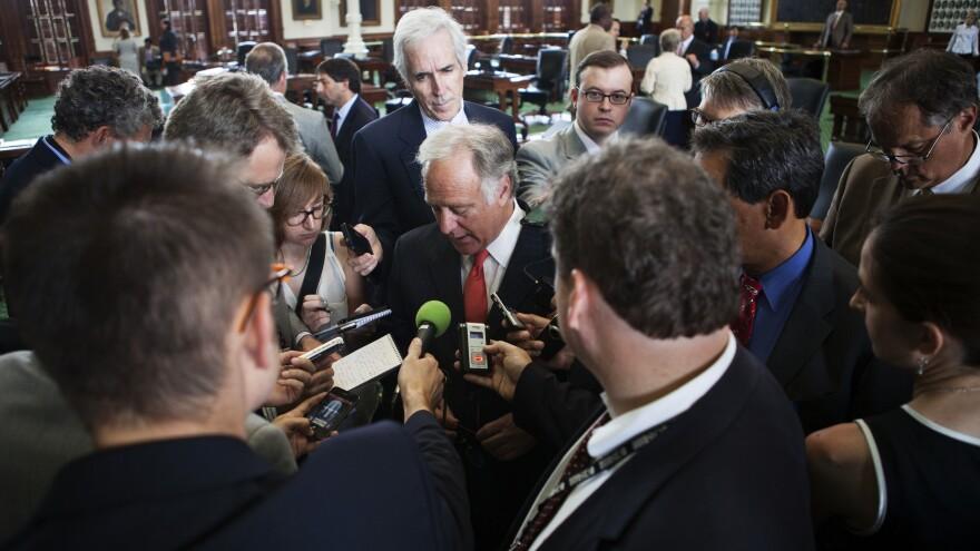 Texas reporters surround state Sen. Kirk Watson, D-Austin, on Monday.
