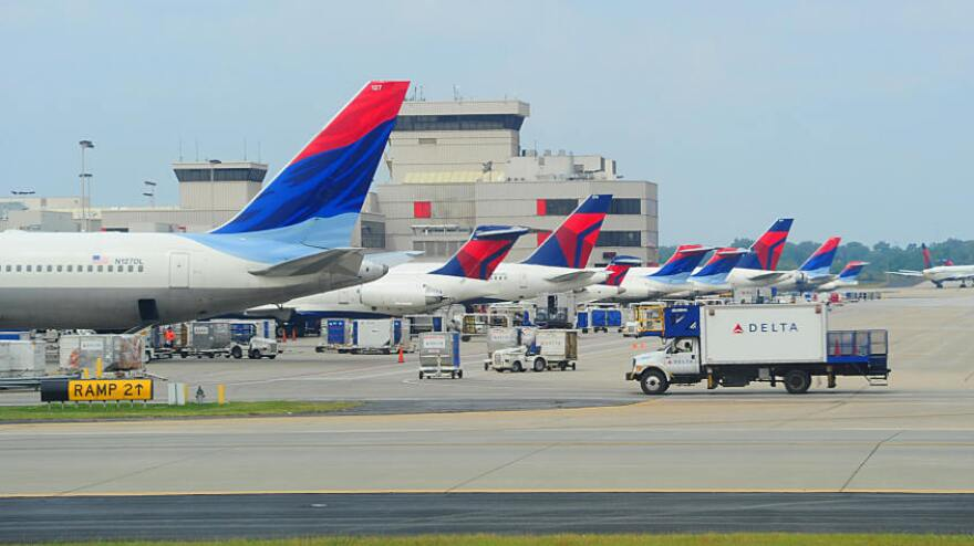 Delta planes line up at the terminal at Hartsfield-Jackson Atlanta International Airport. Southwest Airlines will begin serving the city next month, and hopes to lure passengers away from the hometown airline.