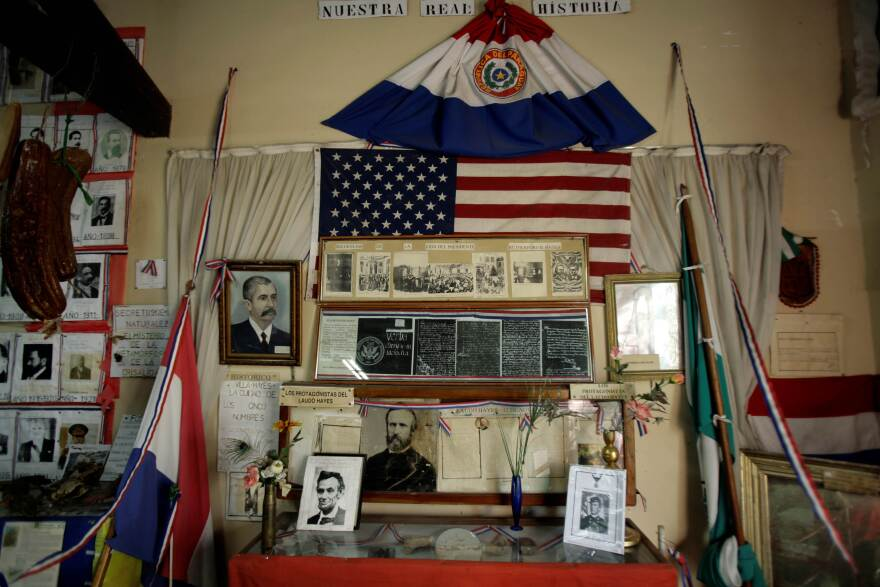 A portrait of Hayes hangs next to a portrait of Abraham Lincoln among other artifacts in the city museum.