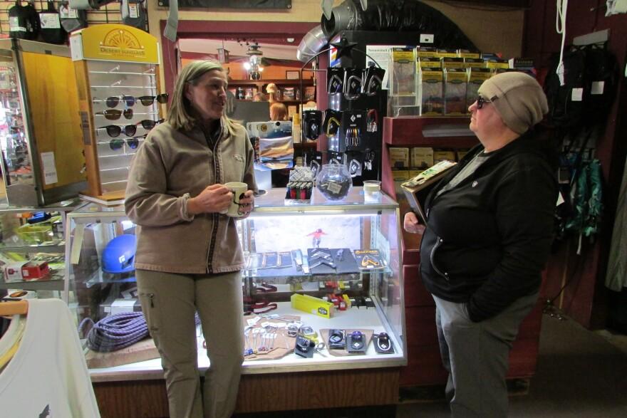 Photo of Susan Hand and customer.