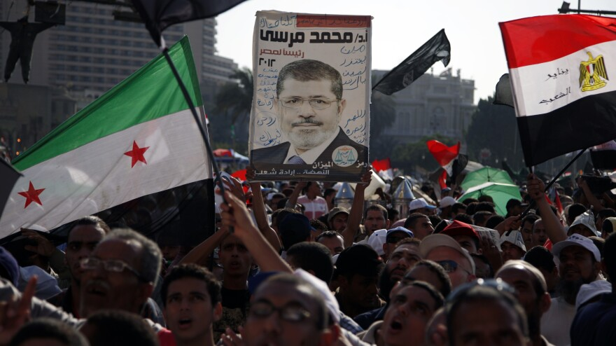 Demonstrators chant slogans supporting Egyptian President Mohammed Morsi during a rally in Tahrir Square in Cairo on Friday.