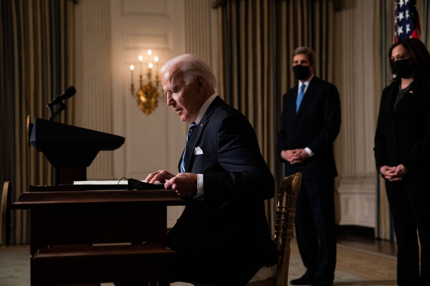 President Joe Biden prepares to sign executive orders after speaking about climate change issues in the State Dining Room of the White House on January 27, 2021 in Washington, DC.