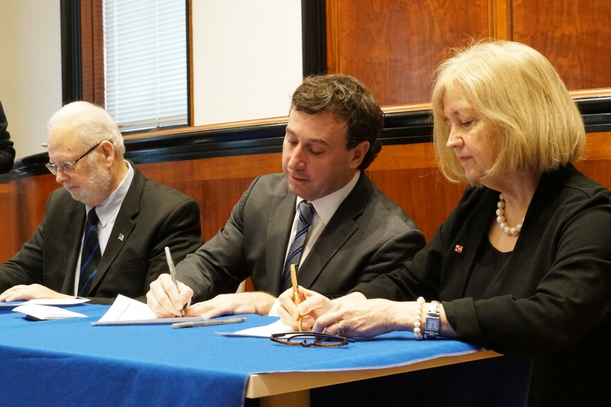 Officials sign the challenge to end homelessness on February 18, 2019. From left to right, Wright City Mayor Dan Rowden, St. Louis County Executive Steve Stenger, St. Louis Mayor Lyda Krewson.