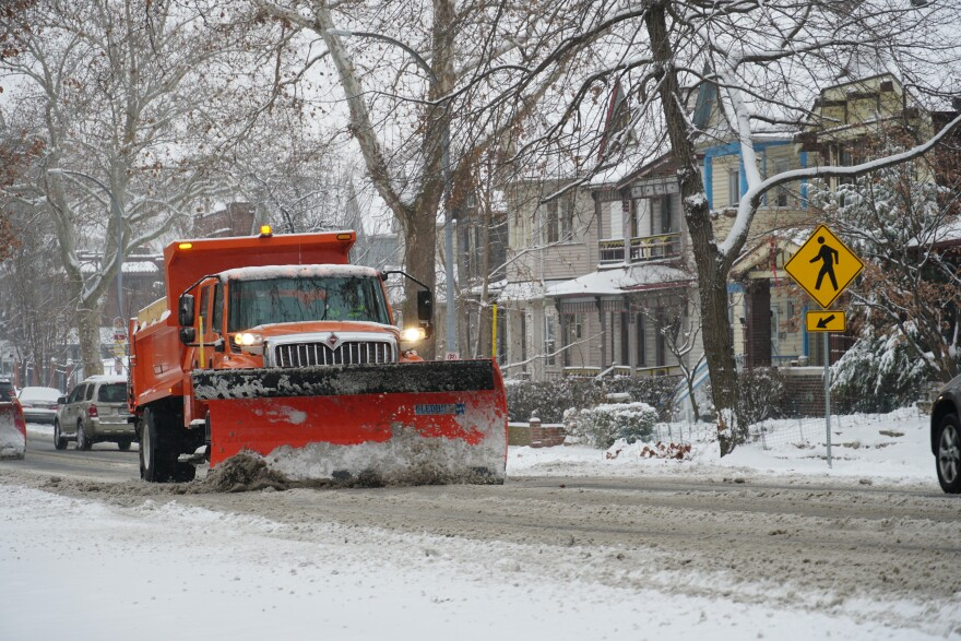 Snow plows clear roadways in St. Louis on Monday afternoon.