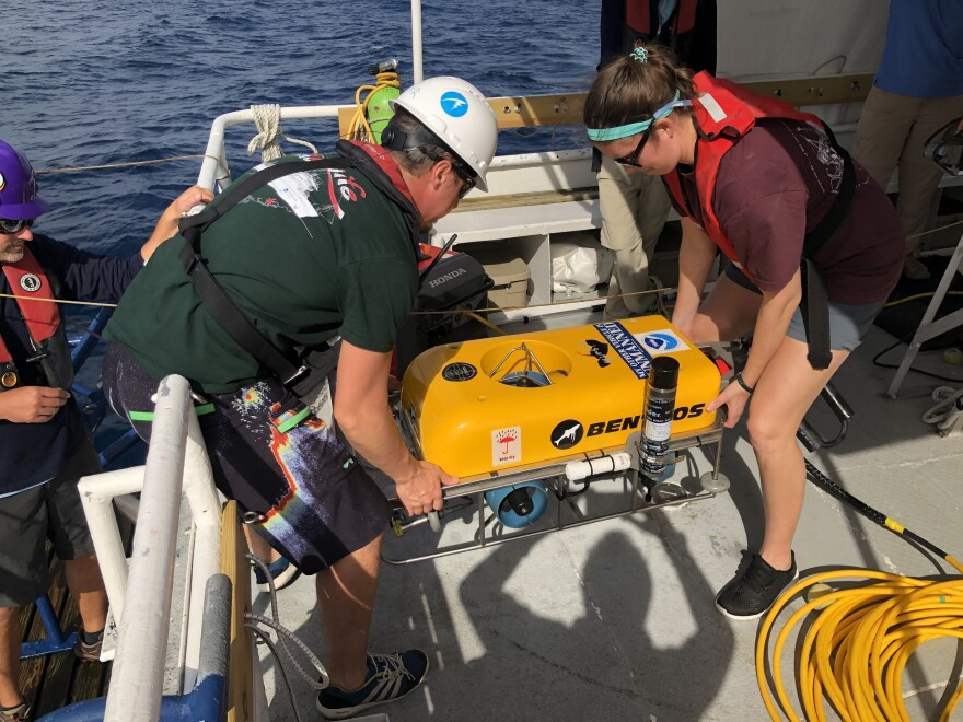 Researchers prepare to lower a drone into the waters off North Carolina's coast.