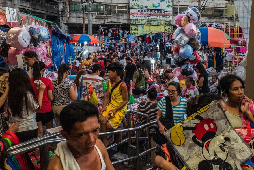 Manila vies for the title of most densely populated city in the world. At the city's crowded markets, like the one above, increasing income has boosted the sales of consumer goods packaged in plastic.