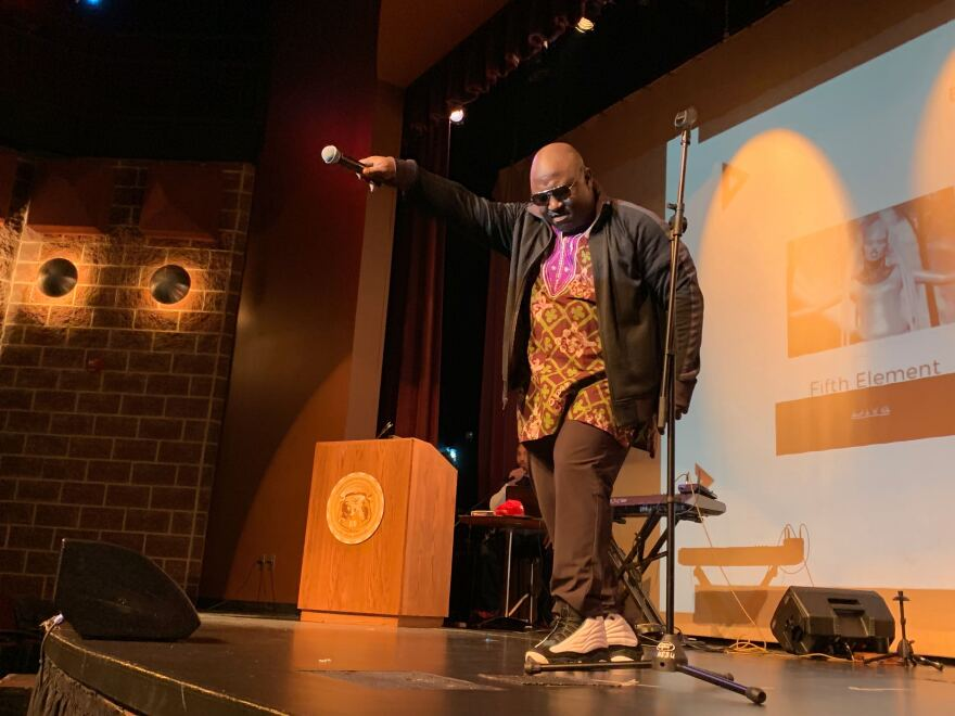 Baritone Robert McNichols Jr., performs a variety of opera sounds behind rap music. This was during the first night of the 2019 Black Speculative Arts Movement.