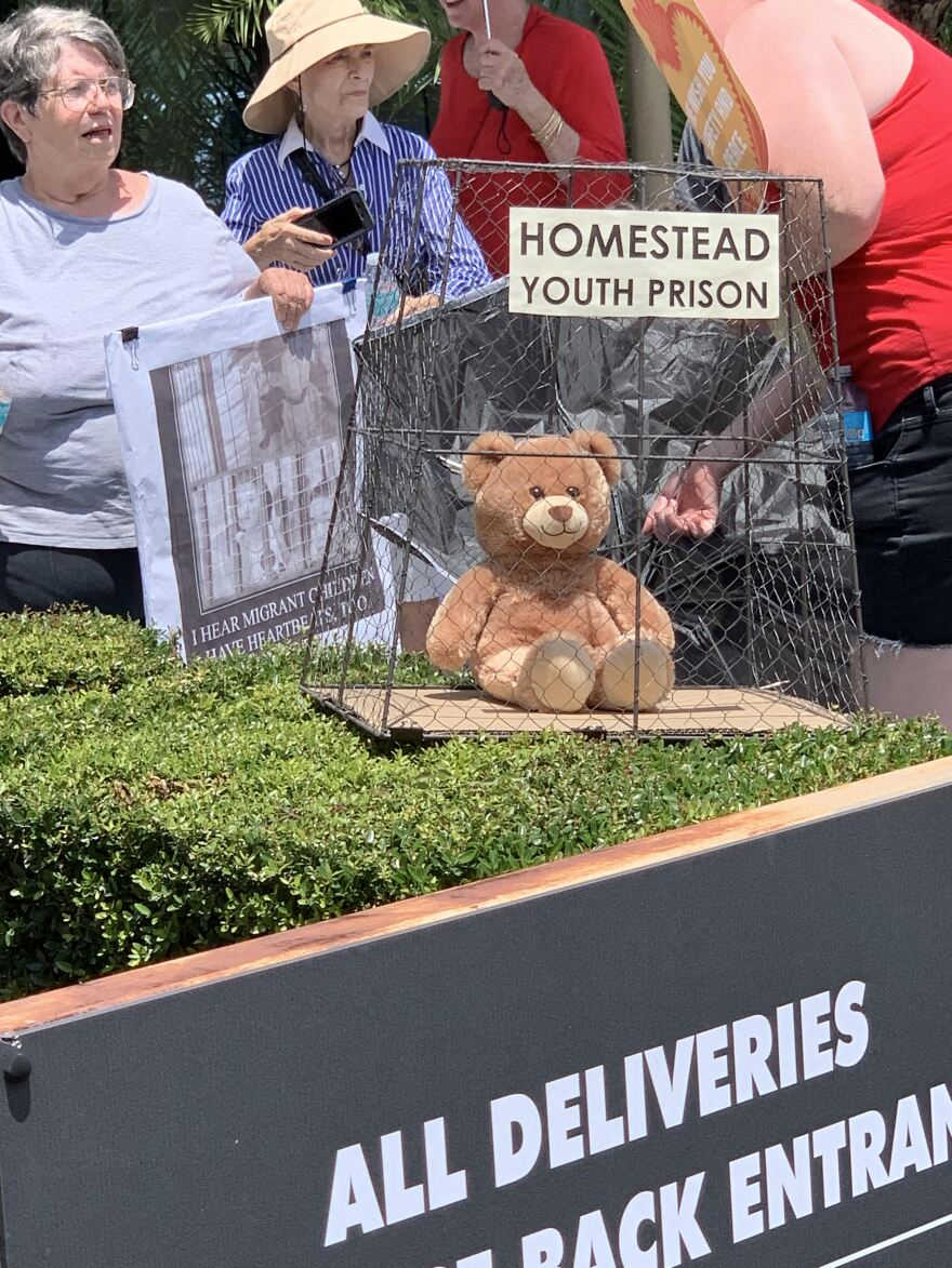 Teddy bear in a cage.