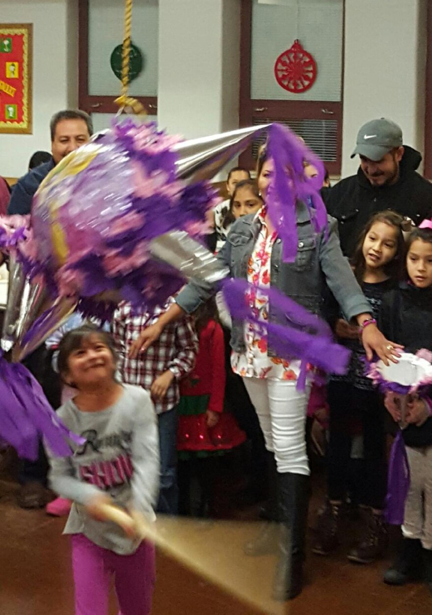 Children swing at a piñata during a Las Posadas celebration at Our Lady of Guadalupe in Ferguson.