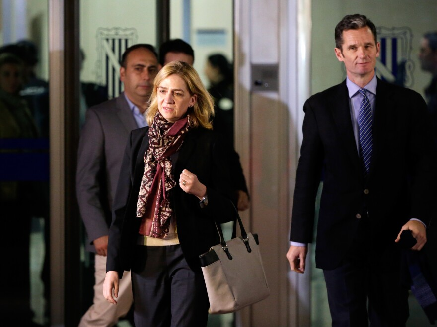 Spain's Princess Cristina and husband, Inaki Urdangarin (right), leave a makeshift courtroom on Monday, the first day of a corruption trial. She is accused of tax fraud and is the first member of Spain's royal family to face criminal charges.