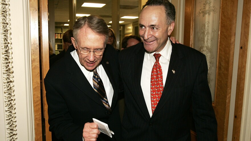 Sen. Harry Reid, left, endorsed and Sen. Chuck Schumer to replace him as Democratic leader.