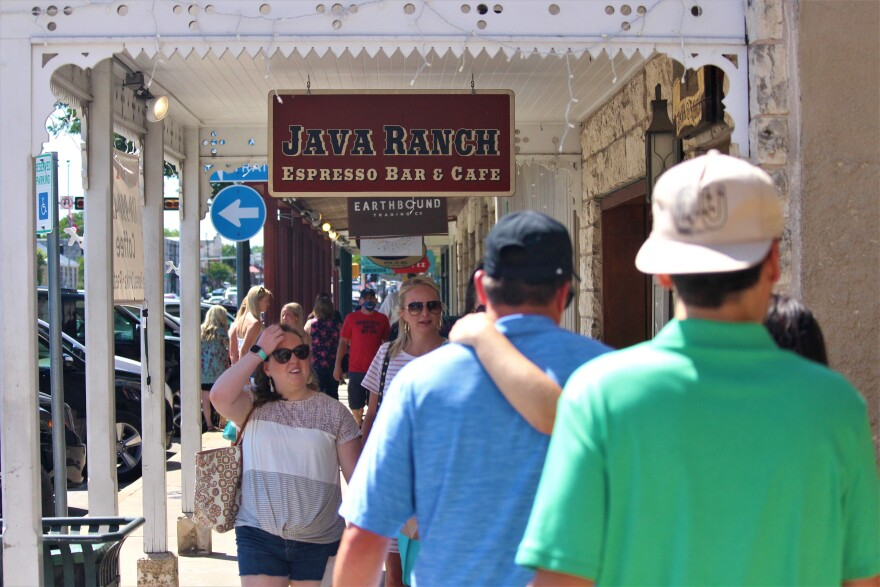 Tourists walk in the city center of Fredericksburg in early June. Just weeks before coronavirus cases began to increase in South Texas, visitation began to pick up after a drop off in March and April.