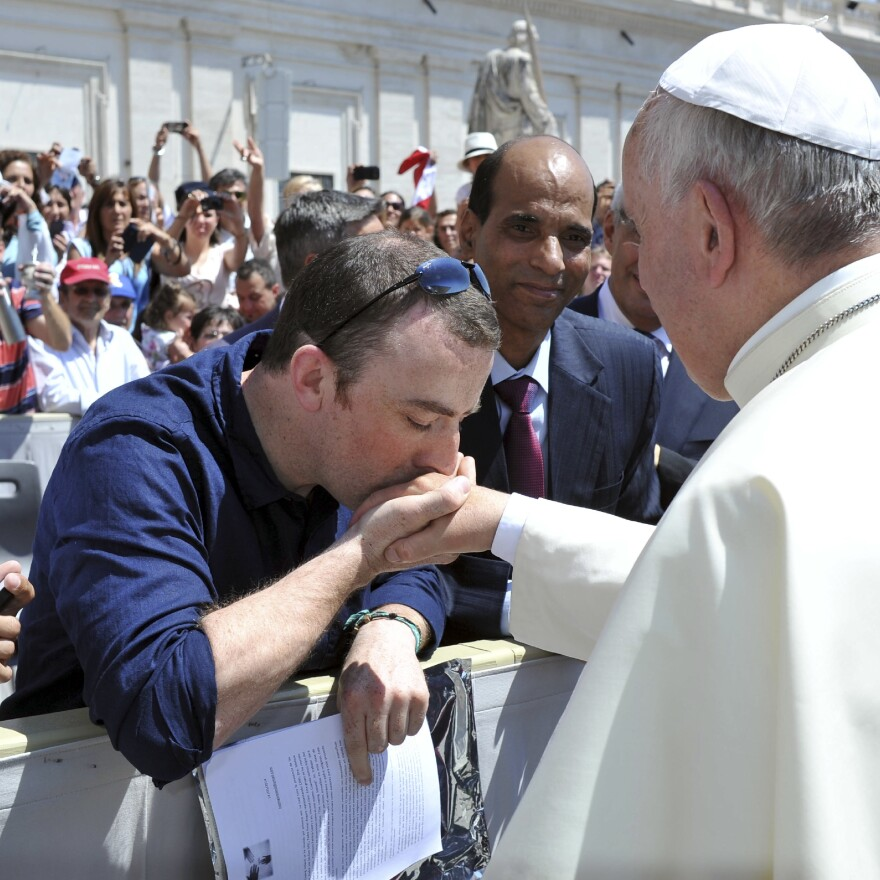 Irish psychotherapist Vincent Doyle kisses Pope Francis' hand during a general audience in the Vatican's St. Peter's Square in 2014. The son of a priest himself, Doyle has sought to carve out a welcoming space for the children of priests — and he has received support from Irish bishops.
