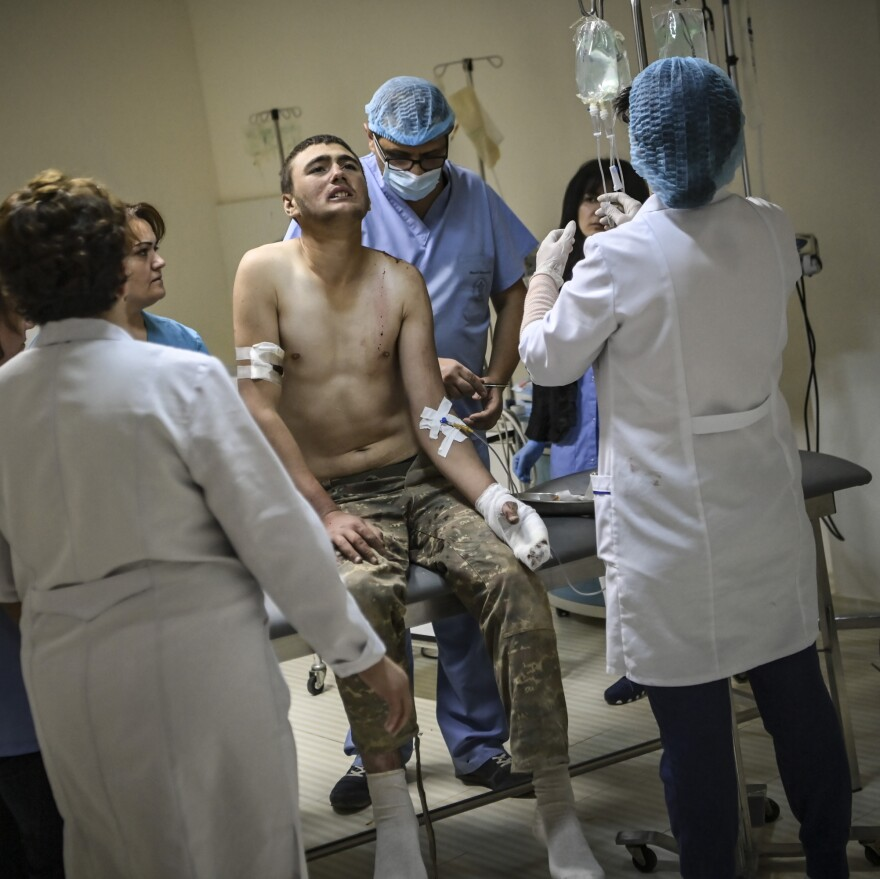 An wounded Armenian soldier getting treatment in the basement of a medical center on Wednesday outside the city of Stepanakert, in the Nagorno-Karabakh region.