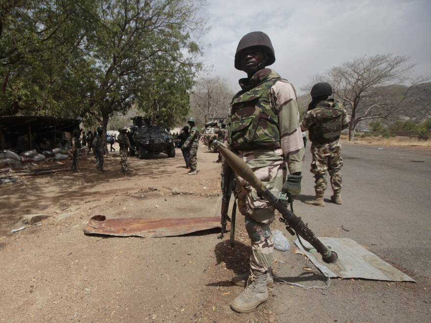 Nigerian soldiers man a checkpoint in Gwoza, Nigeria, in 2015. At the time, the town was newly liberated from Boko Haram.