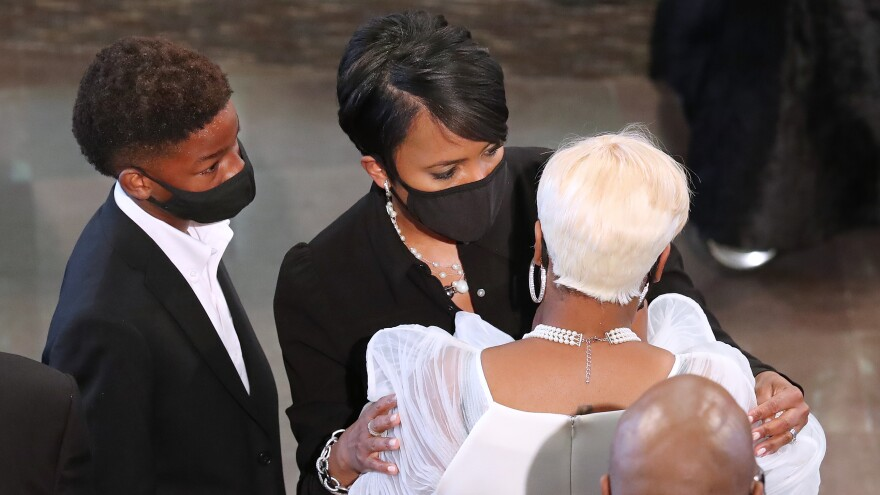 Bottoms consoles Tomika Miller, the wife of Rayshard Brooks, at the conclusion of his June 23 funeral at Ebenezer Baptist Church in Atlanta. Brooks, 27, died June 12 after an officer shot him in a Wendy's parking lot.