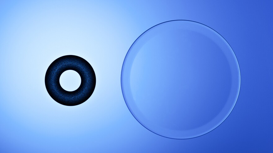 A corneal inlay next to a contact lens.