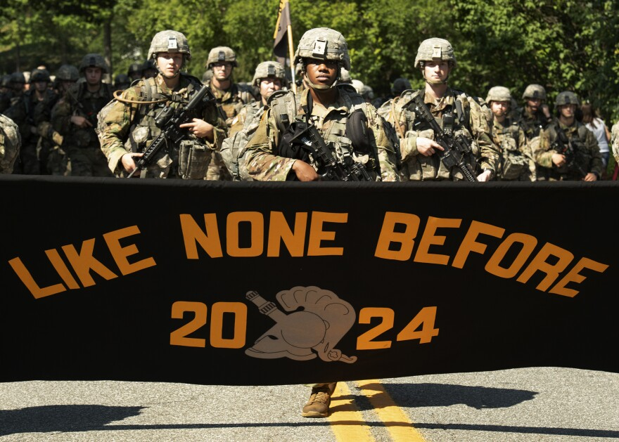 Senior Evan Walker, cadet basic training commander, marches with freshmen as they display their motto on a 12-mile march after finishing up four weeks of basic training on Monday in West Point, N.Y.