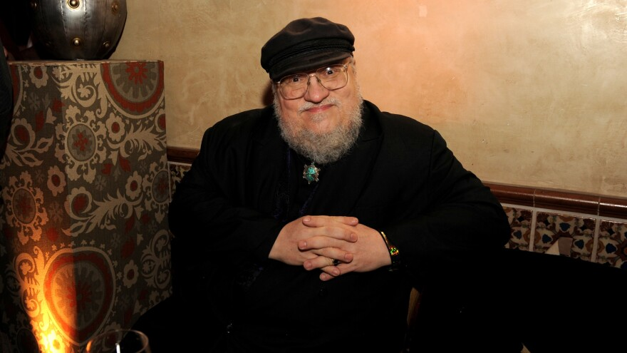 George R.R. Martin attends a 2013 afterparty for HBO's <em>Game Of Thrones</em>, which was adapted from his epic fantasy series, A Song of Ice and Fire.