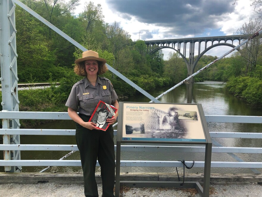CVNP's Arrye Rosser poses along the Cuyahoga with her copy of the 1969 Time Magazine.