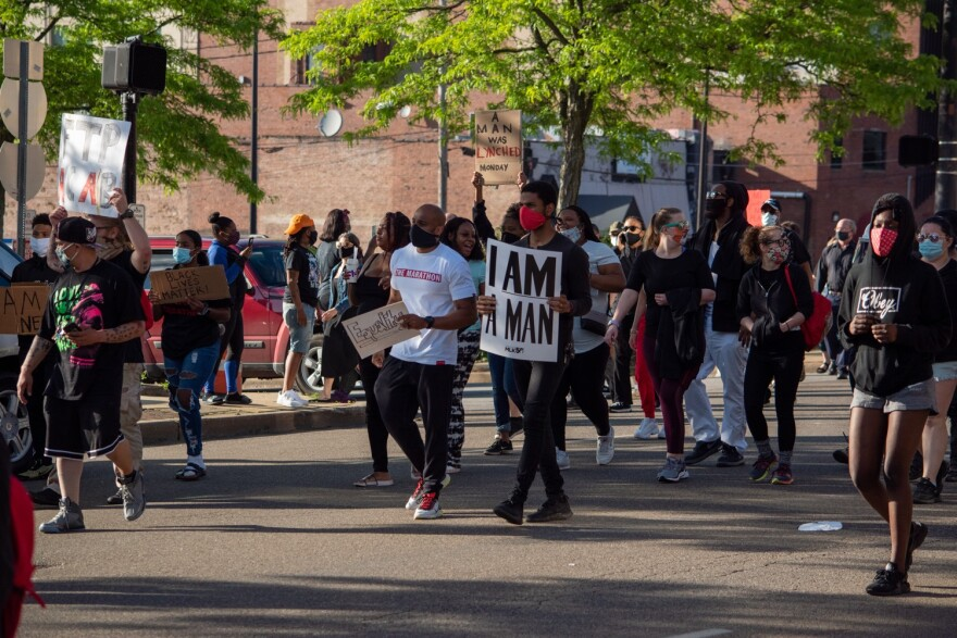 a photo of protesters in Akron