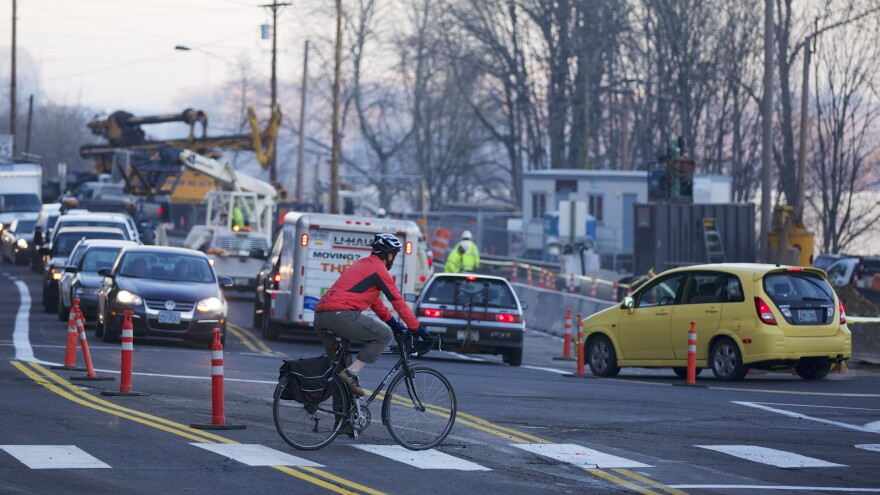 A cyclist rides through a congested intersection in Portland, Oregon; the state is No. 6 on the League of American Bicyclists' new rankings of U.S. states.