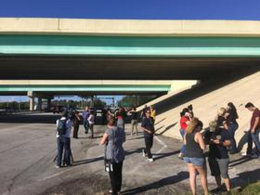 Parents waited at the intersection of the Sawgrass Expressway and Coral Ridge Drive, trying to reunite with their children.