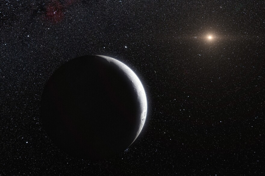 """The new object is one of many dwarf planets orbiting at the edge of the solar system. This artist's conception shows the previous record-holder for distance, a dwarf planet called <a href=""""https://en.wikipedia.org/wiki/Eris_(dwarf_planet)"""">Eris</a>."""