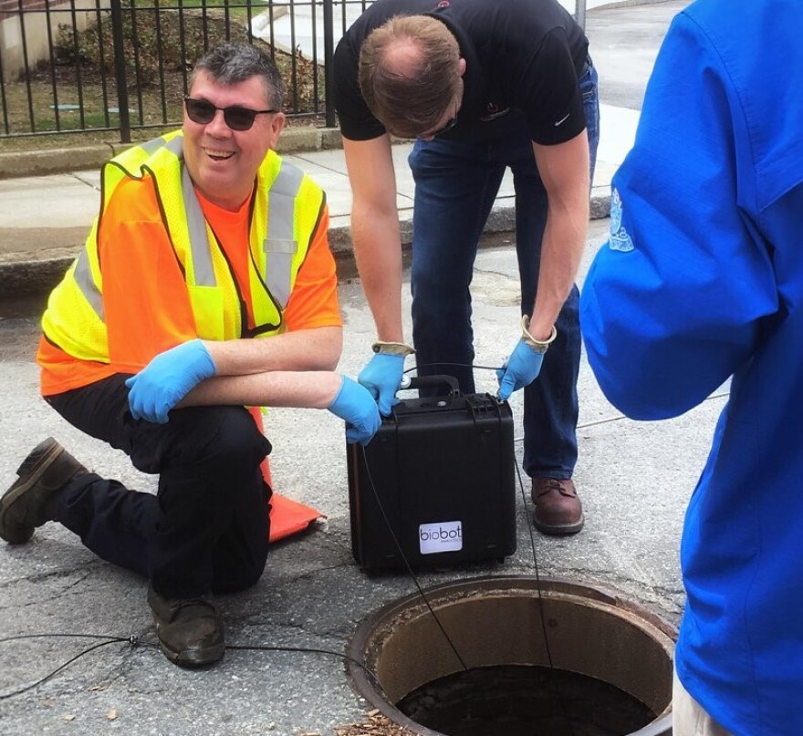 In this undated photo provided by Biobot in June 2020 technicians take a sewage sample.