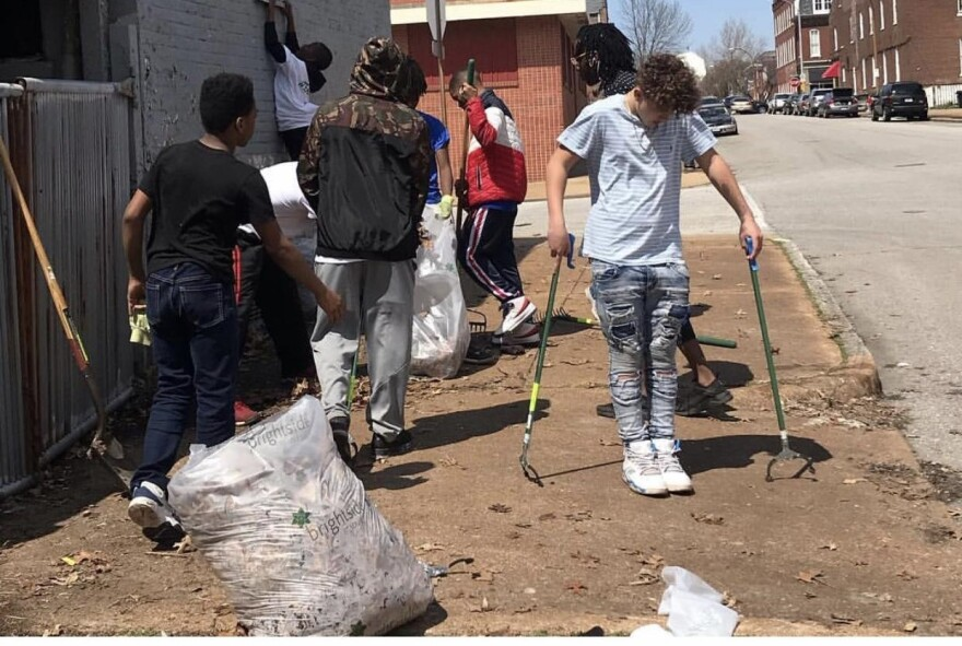 Neighborhood volunteers in Hyde Park clean garbage from the street. Black neighborhoods in St. Louis are more likely to be subject to illegal dumping of potentially hazardous materials. [9/1/19]