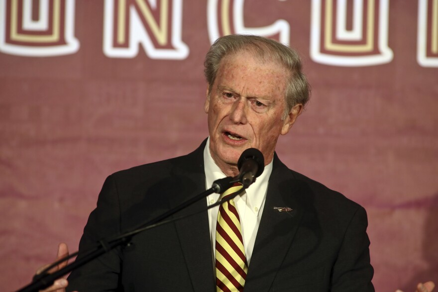 Florida State president John Thrasher speaks at a press conference Sunday, Dec. 8, 2019, in Tallahassee, Fla.  (AP Photo/Phil Sears)