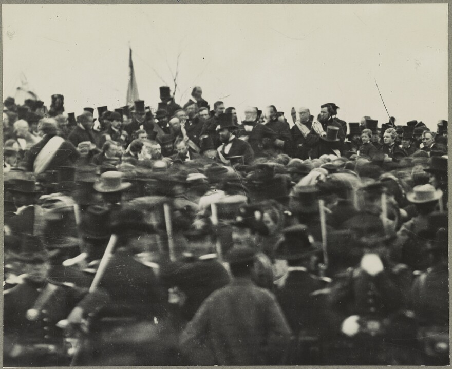 A photo of Abraham Lincoln and crowd during his Gettysburg Address.