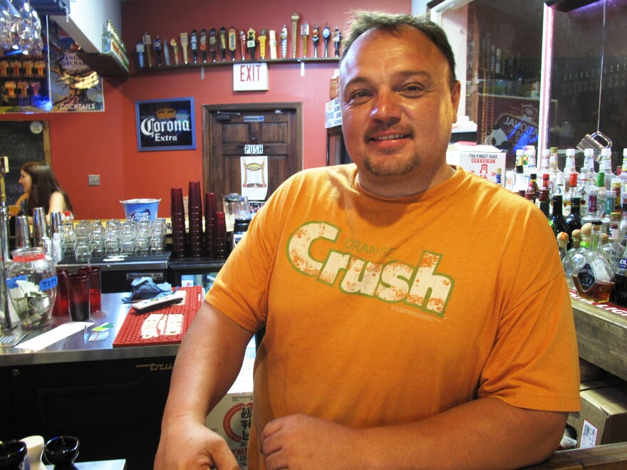 Rich Godlove, owner of Zen-Shi bar and restaurant in Frostburg, Md., says training paid for by the university has helped his staff recognize sophisticated fake IDs.