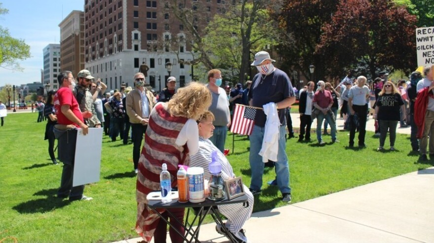 Barbers and hairstylists gave protesters a trim in a demonstration against Michigan's stay-at-home orders at the Capitol in Lansing on Wednesday.