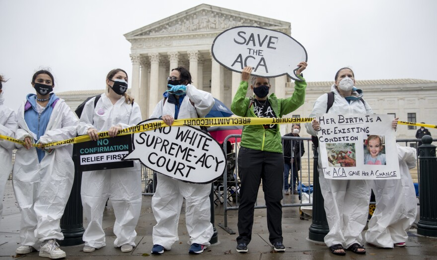 Opponents of Amy Coney Barrett's confirmation gather in front of the Supreme Court on Monday.