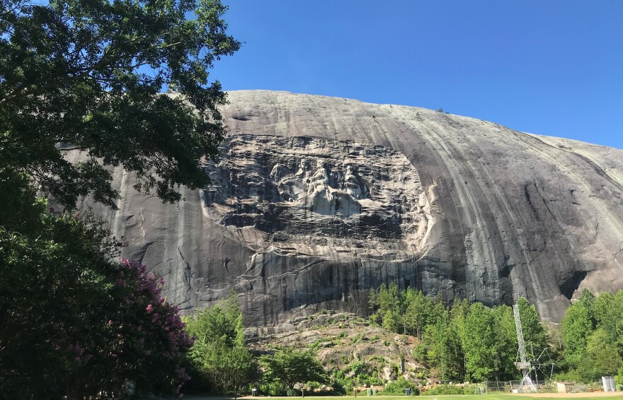 A carving depicting the images of Confederate Generals Stonewall Jackson and Robert E. Lee and president of the Confederacy, Jefferson Davis, is engraved on the side of Stone Mountain.