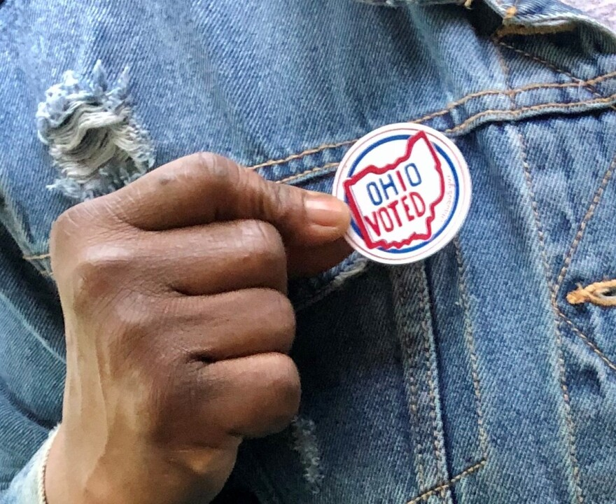 photo of African-American holding a Ohio Voted sticker