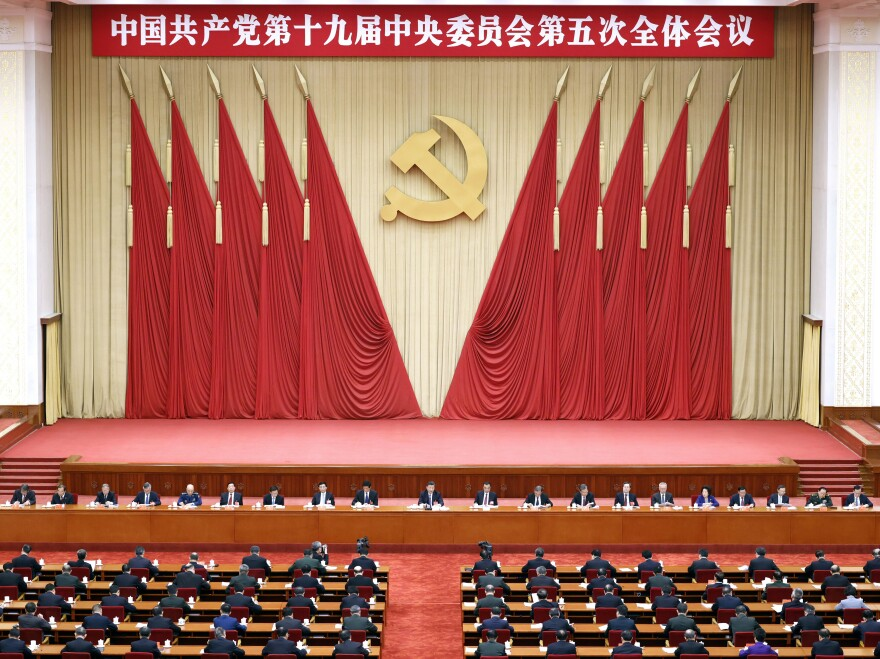 In this photo released by Xinhua News Agency, Chinese President Xi Jinping, center, also general secretary of the Chinese Communist Party, leads the fifth plenary session of the 19th Central Committee of the CCP, in Beijing in October. The U.S. State Dept. Thursday tightened travel restrictions on members of the CCP and their families.