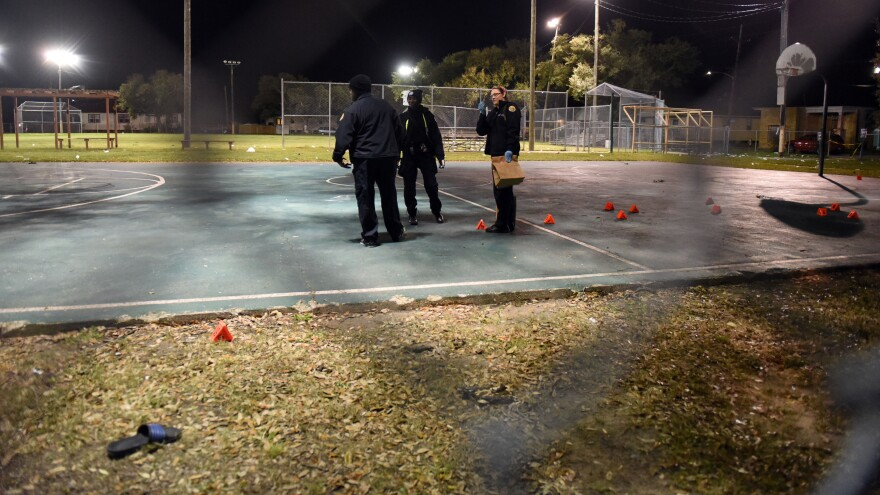 New Orleans police gather evidence after a playground shooting that left at least 16 people injured. City officials are appealing to witnesses for information about the incident.