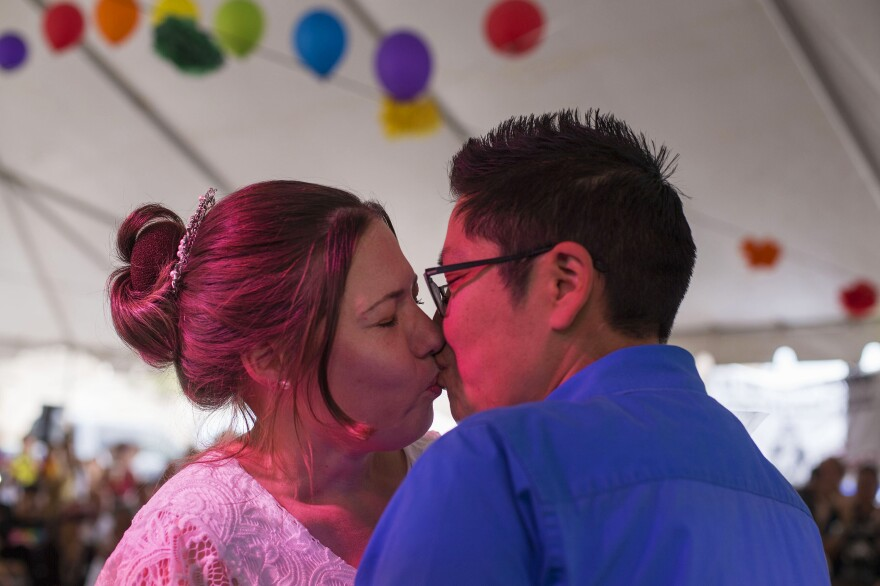 Ophelia Shondee (left) and Bonnie Gillespie kiss during their marriage ceremony at Diné Pride. Same-sex marriage is illegal through Navajo courts, so the couple, who have been together for 13 years, had to get their marriage license through an Arizona court, outside the reservation.